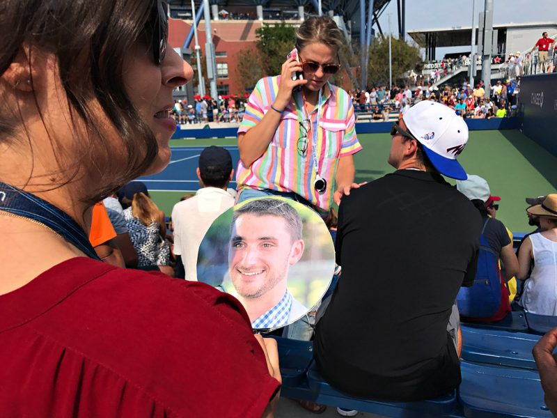 NEW YORK, NY - SEPTEMBER 10:  USTA employees (jena in red) and Lisa (black dress) hold a fan made with a photo of former USTA employee and coworker Jeremy Fehrs during Day Thirteen of the 2016 US Open at the USTA Billie Jean King National Tennis Center on September 10, 2016 in Queens.  They are taking Jeremy's photo throughout the grounds and sending to him since he loves the tournament. (Landon Nordeman for ESPN)