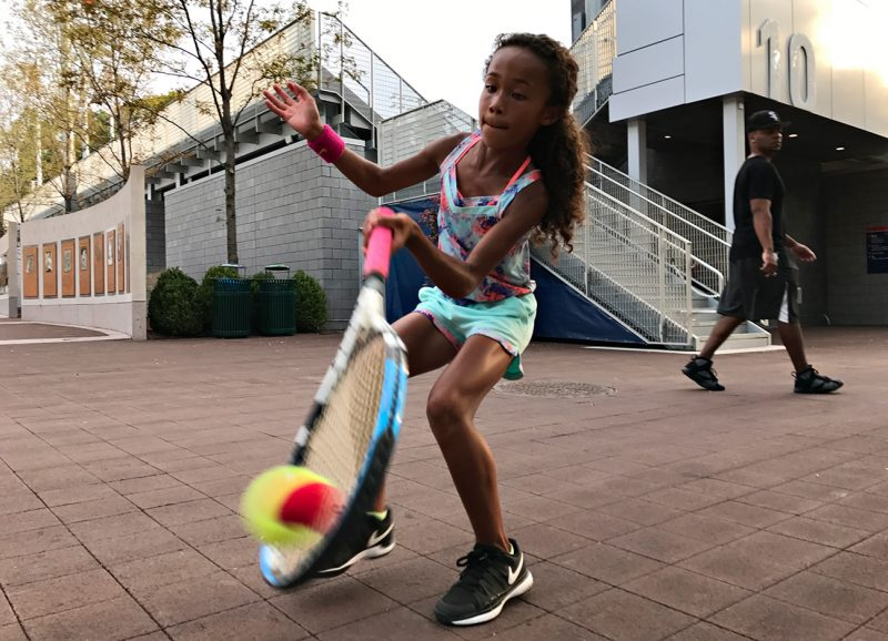 NEW YORK, NY - SEPTEMBER 10:  A young tennis fan Ligaya Murray, 8, from Yonkers, NY plays with her family who are big tennison the grounds during Day Thirteen of the 2016 US Open at the USTA Billie Jean King National Tennis Center on September 10, 2016 in Queens.  (Landon Nordeman for ESPN)
