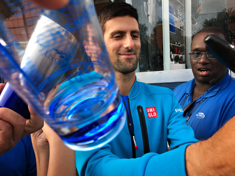 NEW YORK, NY - SEPTEMBER 10:  Novak Djokovic signs autographs after appearing on television on Day Thirteen of the 2016 US Open at the USTA Billie Jean King National Tennis Center on September 10, 2016 in Queens.  (Landon Nordeman for ESPN)