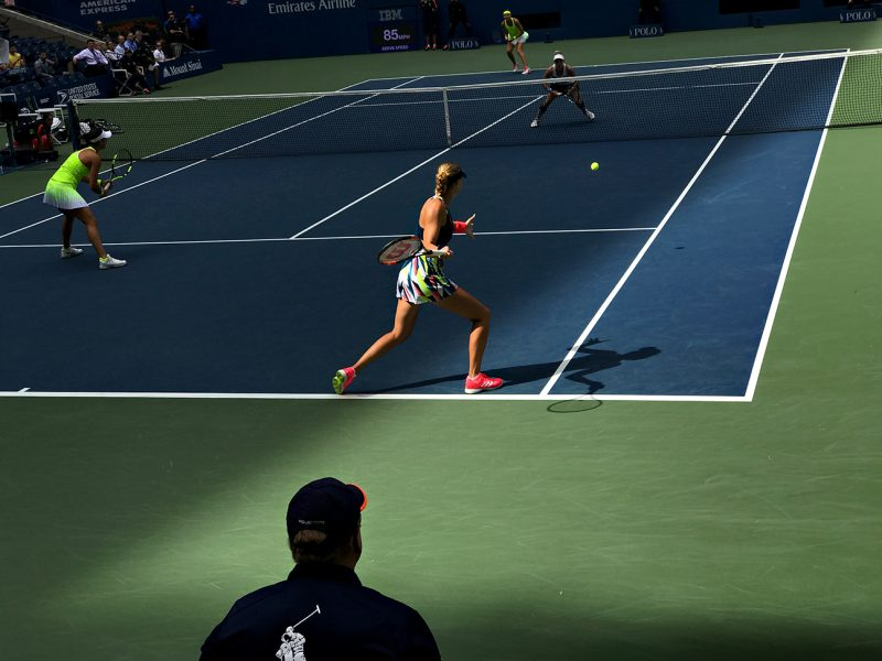 NEW YORK, NY - SEPTEMBER 11:  Caroline Garcia (FRA) and Kristina Mladenovic (FRA) serve to Bethanie Mattek-Sands (USA) [12] and Lucie Safarova (CZE) [12]during the women's doubles finals in Arthur Ashe as the roof casts a shadow across the court on Day 14 of the 2016 US Open at the USTA Billie Jean King National Tennis Center on September 11, 2016 in Queens.  (Landon Nordeman for ESPN)