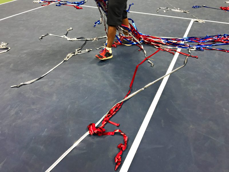 NEW YORK, NY - SEPTEMBER 11:  Streamers are cleaned up on center court after the trophy celebration for Stan Wawrinka defeating Novak Djokovic on Day 14 of the 2016 US Open at the USTA Billie Jean King National Tennis Center on September 11, 2016 in Queens.  (Landon Nordeman for ESPN)