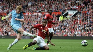 Manchester City's Belgian midfielder Kevin De Bruyne (L) hits the post with this attempt during the English Premier League football match between Manchester United and Manchester City at Old Trafford in Manchester, north west England, on September 10, 2016. / AFP PHOTO / Oli SCARFF / RESTRICTED TO EDITORIAL USE. No use with unauthorized audio, video, data, fixture lists, club/league logos or 'live' services. Online in-match use limited to 75 images, no video emulation. No use in betting, games or single club/league/player publications.  /
