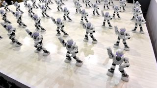 "JINAN, CHINA - AUGUST 25:  More than 50 robots dance during the opening ceremony of the sixth Shandong Cultural Industries Fair (SDCIF) at Jinan International Convention & Exhibition Center on August 25, 2016 in Jinan, Shandong Province of China.The 50 robots are named ""Alpha"" and are connected to cellphones instructing them to perform different actions according to various musical sounds.  (Photo by VCG/VCG via Getty Images)"