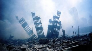 (FILES) This file photo taken on September 11, 2001 shows the rubble of the World Trade Center smouldering following the collapse of the towers.The Twin Towers of the World Trade Center which were struck by hijacked airplanes collapsed on that day claiming 2,753 lives. September 6, 2016 marks the fifteenth anniversary of the event. / AFP PHOTO / ALEXANDRE FUCHS