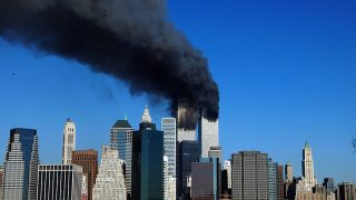 (FILES) This file photo taken on September 11, 2001 shows the Twin Towers of the World Trade Center in New York billowing smoke after hijacked airliners crashed into them. The towers collapsed on that day claiming 2,753 lives. September 11, 2016 marks the fifteenth anniversary of the event. / AFP PHOTO / HENNY RAY ABRAMS