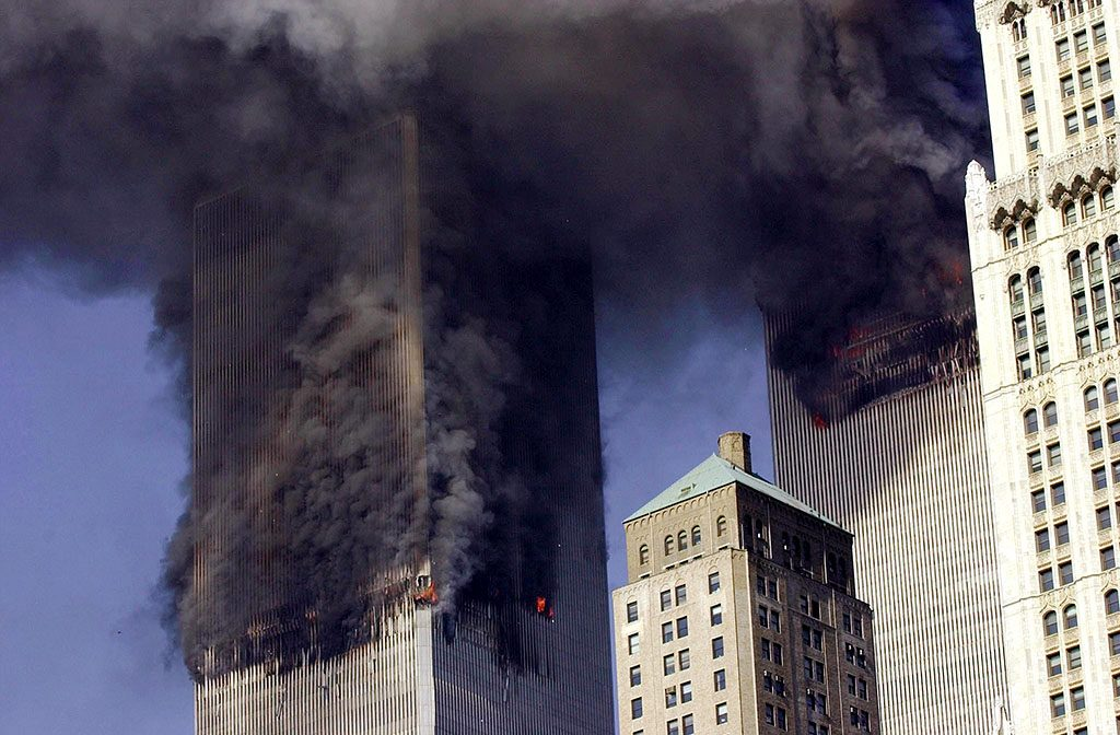 (FILES) This file photo taken on September 11, 2001 shows the Twin Towers of the World Trade Center burning after two planes crashed into each building in New York.The buildings collapsed on that day claiming 2,753 lives. September 11, 2016 marks the fifteenth anniversary of this event. / AFP PHOTO / STAN HONDA