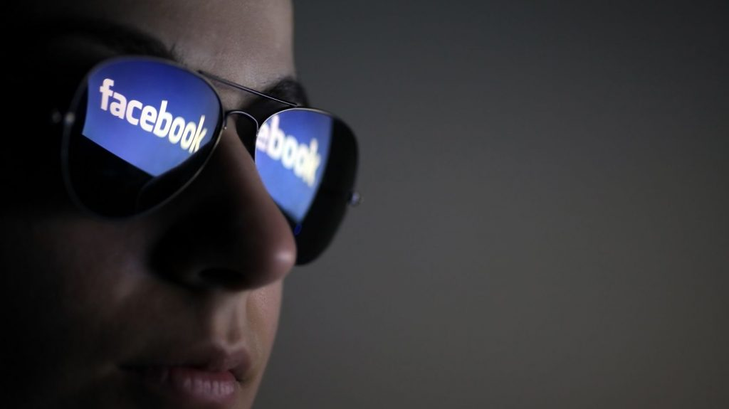 12993596 - bucharest, romania - march 27, 2012: facebook logo is reflected in a pair of glasses. facebook is a social networking service launched in february 2004, having more than 845 million active users.