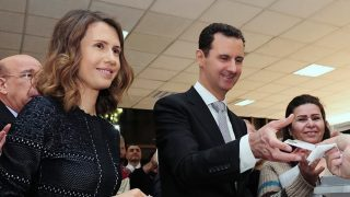 "A handout picture made available on the Syrian Presidency Facebook page on April 13, 2016 shows Syrian President Bashar al-Assad (C) and his wife Asma (L) voting at a polling station in Damascus during the parliamentary elections. Syrians went to the polls in areas controlled by Assad's regime for parliamentary elections dismissed by the opposition as illegitimate. Around 7,200 polling stations opened at 7:00 am (0400 GMT) in government-held areas -- around a third of the country's territory where about 60 percent of the population lives.      / AFP PHOTO / Syrian Presidency Facebook page / STRINGER / RESTRICTED TO EDITORIAL USE - MANDATORY CREDIT ""AFP PHOTO / SYRIAN PRESIDENCY FACEBOOK PAGE /STRINGER"" - NO MARKETING NO ADVERTISING CAMPAIGNS - DISTRIBUTED AS A SERVICE TO CLIENTS"