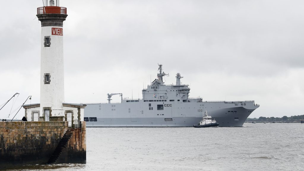 """The Egyptian Gamal Abdl """"Nasser"""" (formally named """"Vladivostok"""") Mistral class ship leaves the harbour of Saint-Nazaire, western France, on June 12, 2016.  The """"Nasser"""", the first of two Mistral class ships sold by France to Egypt after its first sale cancellation to Russia, leaves Saint-Nazaire (Loire-Atlantique) for Alexandria, its home harbour on June 12.  / AFP PHOTO / JEAN-SEBASTIEN EVRARD"""