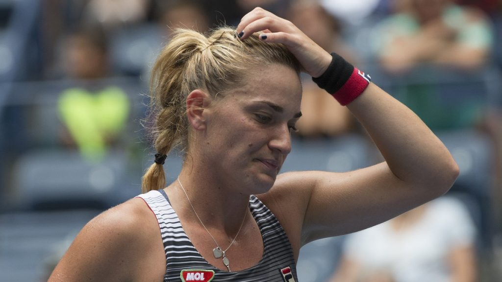 Timea Babos of Hungary reacts to a point against Simona Halep of Romania during their 2016 US Open women's singles match at the USTA Billie Jean King National Tennis Center on September 3, 2016 in New York. / AFP PHOTO / Don EMMERT
