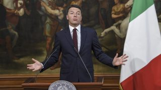 Italian Prime Minister Matteo Renzi gestures during a press conference for reconstruction efforts for areas and victims affected by the August 24 earthquake on September 23, 2016 at the Palazzo Chigi in Rome.  / AFP PHOTO / ANDREAS SOLARO