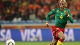 (FILES) This file photo taken on June 24, 2010 shows Cameroon's defender Rigobert Song eyeing the ball during the Group E first round 2010 World Cup football match against Cameroon on June 24, 2010 at Green Point stadium in Cape Town.  Cameroon's coach Rigobert Song, 40, suffered a stroke in Yaounde on October 2, 2016 and is in a coma, reported the Cameroon Radio television (CRTV). / AFP PHOTO / CARL DE SOUZA