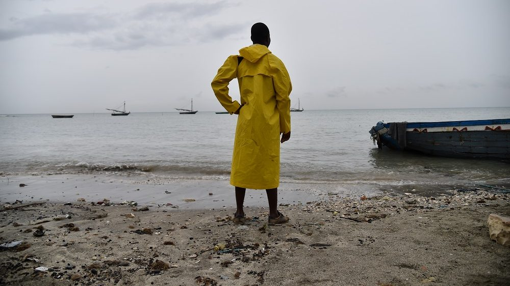 A fisherman looks at the sea in Caira beach, in the commune of Leogane, to the southwest from Port-au-Prince, on October 3, 2016.  Hurricane Matthew has left one person dead and another missing in Haiti, officials said Monday, as it churns through the Caribbean as the worst storm in nearly a decade.A boat with three fishermen capsized Friday off the coast of southern Haiti. Two managed to make it ashore but the body of the other was found later, civil protection authorities said.   / AFP PHOTO / HECTOR RETAMAL