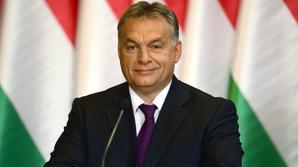 Hungarian Prime Minister Viktor Orban attends a press conference on the last weekand's referendum in Hungary in Budapest on October 4, 2016.  Hungary's prime minister on Monday vowed that Budapest would still reject the EU's controversial migrant quota plan, despite low turnout in a referendum on the issue invalidating the vote.  / AFP PHOTO / ATTILA KISBENEDEK