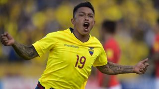 Ecuador's Cristian Ramirez celebrates after scoring against Chile during their Russia 2018 World Cup football qualifier match in Quito, on October 6, 2016. / AFP PHOTO / RODRIGO BUENDIA
