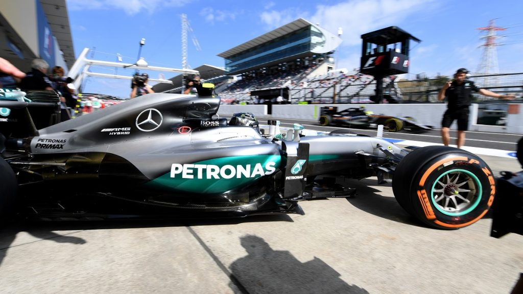 Mercedes AMG Petronas F1 Team's German driver Nico Rosberg leaves his pit during the first free practice session at the Formula One Japanese Grand Prix in Suzuka on October 7, 2016. / AFP PHOTO / TOSHIFUMI KITAMURA
