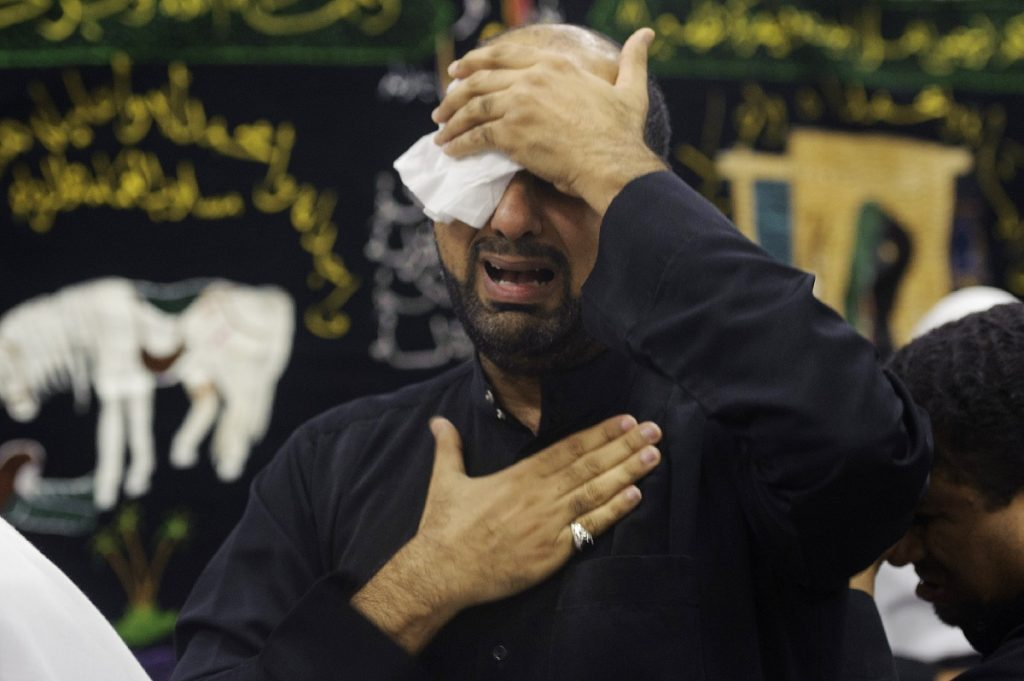 A Saudi Shiite Muslim man takes part in commemorations on the tenth day of the mourning period of Muharram, which marks the day of Ashura, on October 12, 2016, in the Shiite-dominated Gulf coast city of Qatif. Ashura mourns the death of Imam Hussein, a grandson of the Prophet Mohammed, who was killed by armies of the Yazid near Karbala in 680 AD. / AFP PHOTO / STRINGER