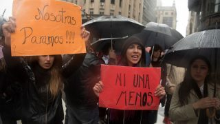 """Women stop work and other activities for an hour to join a """"women's strike"""" organized after the brutal killing of a 16-year-old girl, in Buenos Aires, on October 19, 2016. The brutal killing of a teenager who was allegedly raped and impaled on a spike by drug dealers has sparked outrage in Argentina. Lucia Perez, a high school student in the resort city of Mar del Plata, died on October 8 after being brought to the hospital by two men who said she had overdosed on drugs. But after doctors noticed signs of violent sexual penetration, investigators pieced together a different story.  / AFP PHOTO / Eitan ABRAMOVICH"""