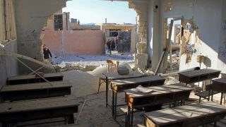 A general view shows a damaged classroom at a school after it was hit in an air strike in the village of Hass, in the south of Syria's rebel-held Idlib province on October 26, 2016. / AFP PHOTO / Omar haj kadour