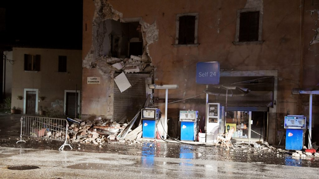 A picture shows a destroyed gas station in the village of Visso, central Italy, after earthquakes on October 26, 2016. Twin earthquakes rocked central Italy on October 26, 2016 -- the second registering at a magnitude of 6.0 -- in the same region struck in August by a devastating tremor that killed nearly 300 people. The quakes were felt in the capital Rome, sending residents running out of their houses and into the streets. The second was felt as far away as Venice in the far north, and Naples, south of the capital. / AFP PHOTO / TIZIANA FABI