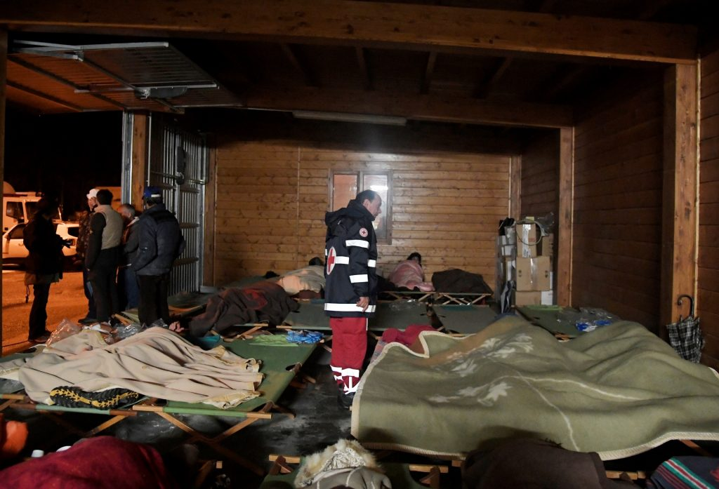 People gather to sleep in a secured area after earthquakes in the village of Visso, central Italy, on October 26, 2016. Twin earthquakes rocked central Italy on October 26, 2016 -- the second registering at a magnitude of 6.0 -- in the same region struck in August by a devastating tremor that killed nearly 300 people. The quakes were felt in the capital Rome, sending residents running out of their houses and into the streets. The second was felt as far away as Venice in the far north, and Naples, south of the capital. / AFP PHOTO / TIZIANA FABI