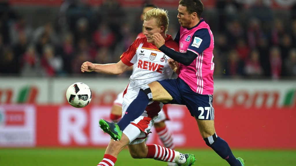 Hamburg's midfielder Nicolai Mueller (R) and Cologne's Danish defender Frederik Soerensen vie for the ball during the German first division Bundesliga football match between 1 FC Cologne and Hamburger SV in Cologne, western Germany, on October 30, 2016. / AFP PHOTO / PATRIK STOLLARZ / RESTRICTIONS: DURING MATCH TIME: DFL RULES TO LIMIT THE ONLINE USAGE TO 15 PICTURES PER MATCH AND FORBID IMAGE SEQUENCES TO SIMULATE VIDEO. == RESTRICTED TO EDITORIAL USE == FOR FURTHER QUERIES PLEASE CONTACT DFL DIRECTLY AT + 49 69 650050