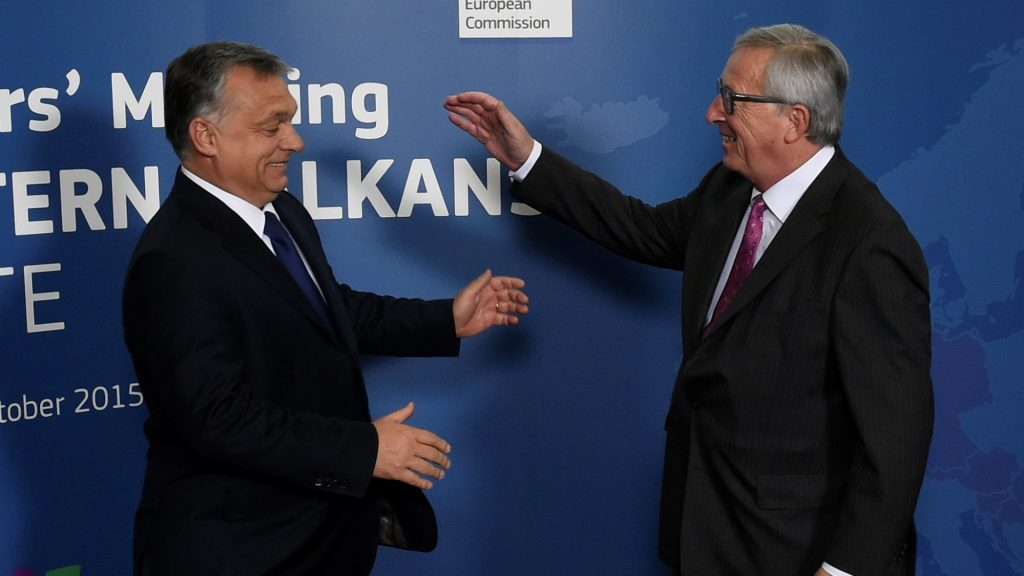 EU Commission president Jean-Claude Juncker (R) greets Hungarian Prime Minister Viktor Orban ahead of an EU-Balkans mini summit at the EU headquarters in Brussels on October 25, 2015. European Union and Balkan leaders faced a make-or-break summit on the deepening refugee crisis after three frontline states threatened to close their borders if their EU peers stopped accepting migrants. AFP PHOTO / JOHN THYS / AFP PHOTO / JOHN THYS