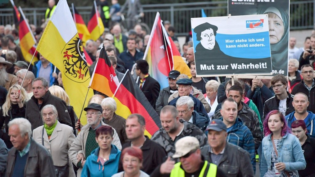 Participants of an AfD demonstration under the motto 'Protecting borders, creating social security' walk through the city of Erfurt, Germany, 21 September 2016. The demonstration parade with around 1500 participants started at the main station and moved onwards to the Thurigian Landtag. PHOTO: MARTIN SCHUTT/dpa