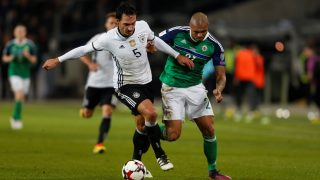 HANOVER, GERMANY - OCTOBER 11: Mats Hummels (L) of Germany is in action against Josh Magenni (R) of Northern Ireland during the FIFA 2018 World Cup Qualifier between Germany and Northern Ireland at the HDI-Arena in Hanover, Germany on October 11, 2016. Ina Fassbender / Anadolu Agency