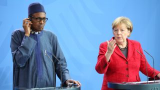 BERLIN, GERMANY - OCTOBER 14: German Chancellor Angela Merkel and Nigerian President Muhammadu Buhari (L) hold a joint press conference after their meeting in Berlin, Germany on October 14, 2016.  Erbil Basay / Anadolu Agency