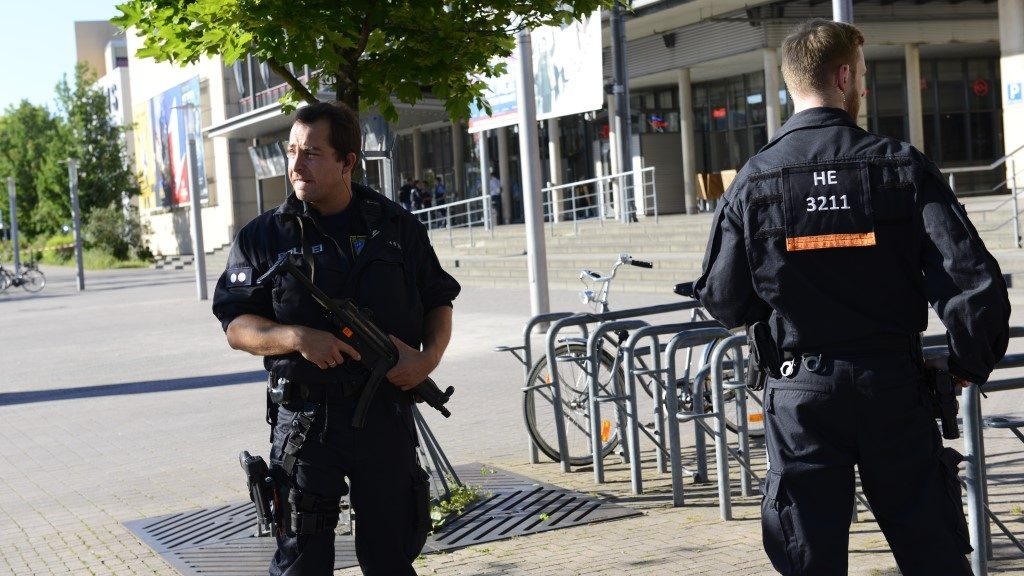 VIERNHEIM, GERMANY - JUNE 23: German police stand outside the movie theatre Kinopolis on June 23, 2016 in Viernheim, Germany. A masked gunman was shot dead during a police operation at a movie theater complex near Frankfurt on Thursday. Peter Beuth, interior minister of the west-central Hesse region, said the suspect was shot dead by special forces police after he took several people hostage at the cinema complex in the small town of Viernheim. Mustafa Borak / Anadolu Agency