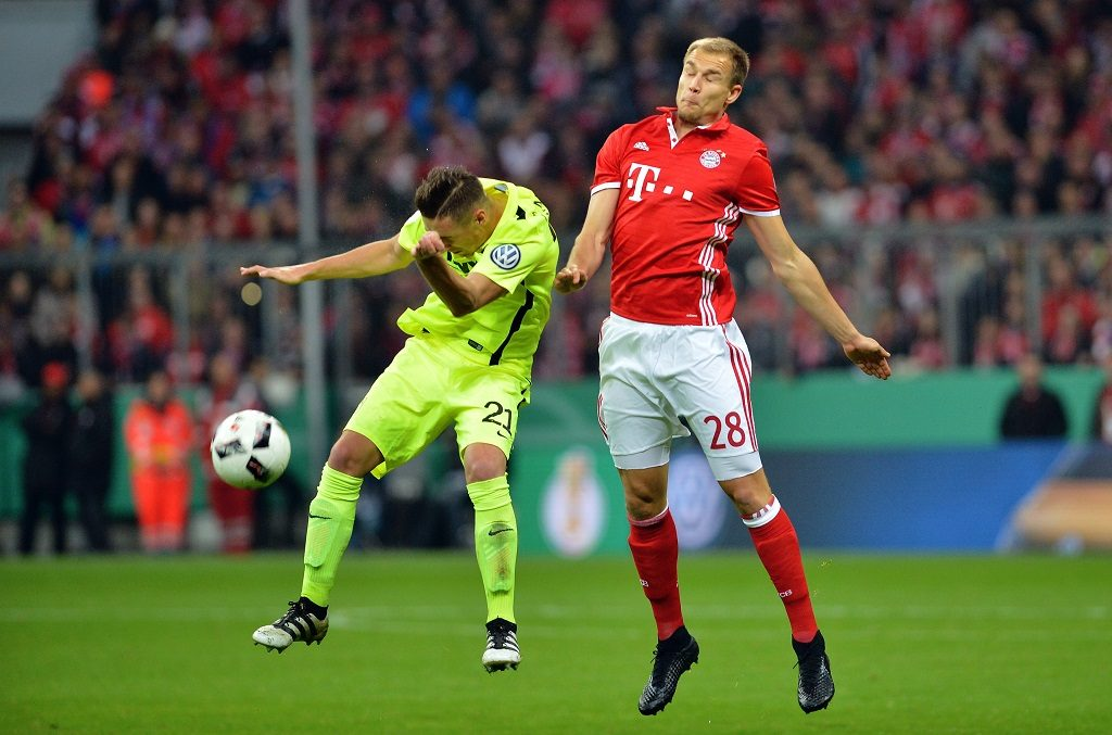 MUNICH, GERMANY - OCTOBER 26:  Holger Badstuber (R) of Munich and Dominik Kohr of Augsburg fight for the ball during the DFB Cup second round match between Bayern Munich and FC Augsburg at Allianz Arena in Munich, Germany on October 26, 2016.  Joerg Koch / Anadolu Agency