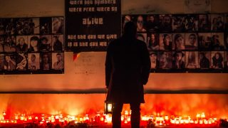BUCHAREST, ROMANIA - DECEMBER 30: A man pays his respect during the commemoration of the fire in the Colectiv club where 63 people were killed and over a hundred injured, on December 30, 2015, in Bucharest, Romania. Andrei Pungovschi / Anadolu Agency