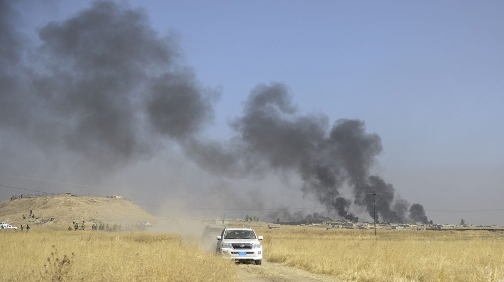 MOSUL, IRAQ - OCTOBER 17 : Smoke rises over Tarjala village  as Peshmerga forces  attack on Deash targets during an operation to liberate Mosul from Daesh terrorist organization on October 17, 2016. A much anticipated Mosul offensive to liberate the city from Daesh began midnight Sunday, according to Iraqi Prime Minister Haider al-Abadi.     Hamit Huseyin / Anadolu Agency
