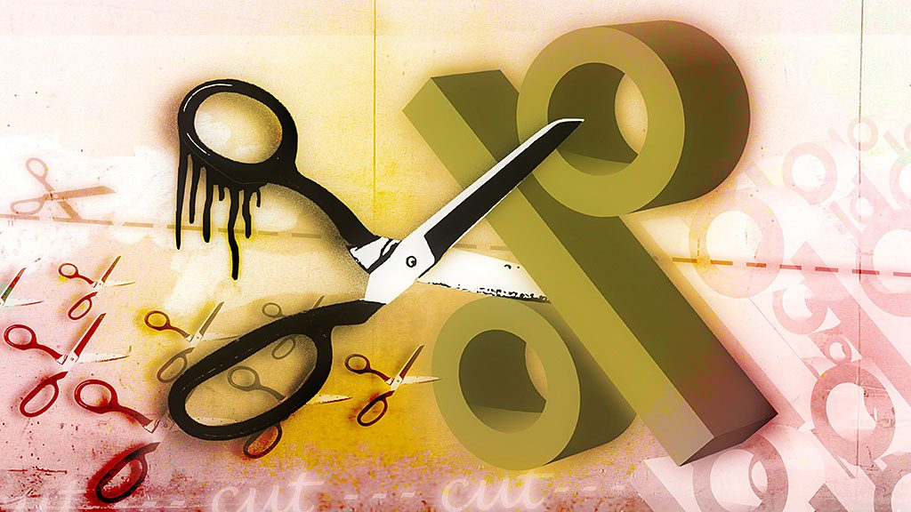 (AUSTRALIA & NEW ZEALAND OUT) Scissors cut up a percentage sign for interest rate cuts (Photo by Fairfax Media via Getty Images)