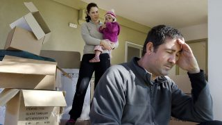 45758308 - young parents and their daughter stand beside cardboard boxes outside their home. concept photo illustrating divorce, homelessness, eviction, unemployment, financial, marriage or family issues.