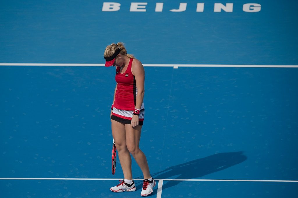 Timea Babos of Hungary reacts after losing a point against Johanna Konta of Britain during their women's singles second round match of the China Open tennis tournament in Beijing on October 5, 2016. / AFP PHOTO / NICOLAS ASFOURI