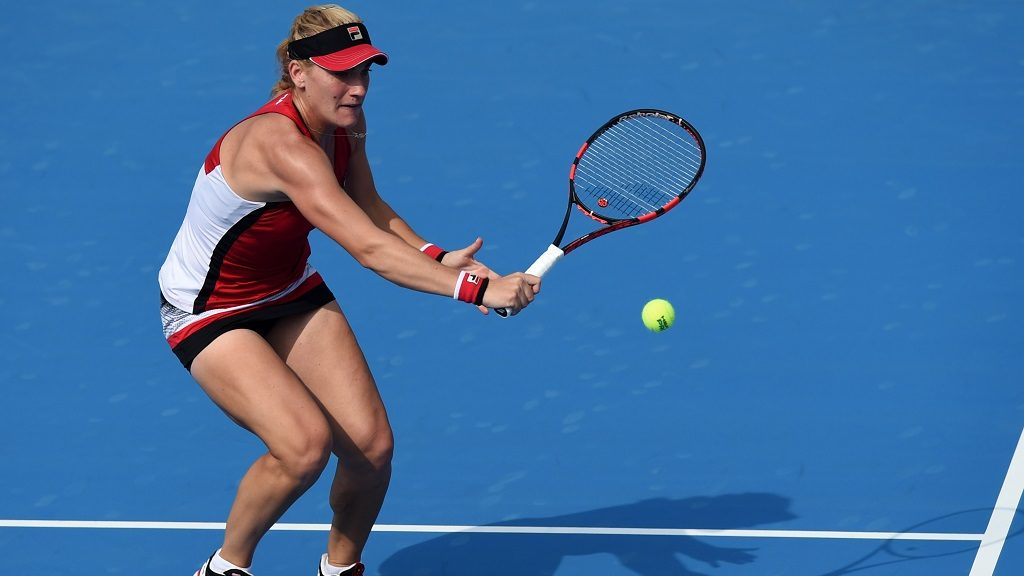 (161005) -- BEIJING, Oct. 5, 2016 (Xinhua) -- Timea Babos of Hungary hits a return to Johanna Konta of Britain during the women's singles second round match at the China Open tennis tournament in Beijing, capital of China, Oct. 5, 2016. Babos lost the match 0-2. (Xinhua/Ju Huanzong)