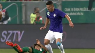 BUDAPEST, HUNGARY - SEPTEMBER 24: Seung-Woo Ryu (L) of Ferencvarosi TC lies on the ground next to Enis Bardhi (R) of Ujpest FC during the Hungarian OTP Bank Liga match between Ferencvarosi TC and Ujpest FC at Groupama Arena on September 24, 2016 in Budapest, Hungary. (Photo by Laszlo Szirtesi/Getty Images)