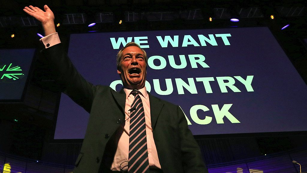"""Leader of the United Kingdom Independence Party (UKIP), Nigel Farage, waves to the audience at a public meeting of the EU Referendum campaign in Gateshead, north east England on June 20, 2016.Divisions have surfaced among pro-Brexit campaigners after UK Independence Party leader Nigel Farage released a poster last Thursday showing immigrants trudging through Europe with a headline in red: """"Breaking Point"""". On that same day, Cox, a 41-year-old mother of two and pro-EU, was on her way to meet members of the public in northern England when an attacker shot and stabbed her, leaving her bleeding on the pavement. She died of her wounds. / AFP PHOTO / SCOTT HEPPELL"""