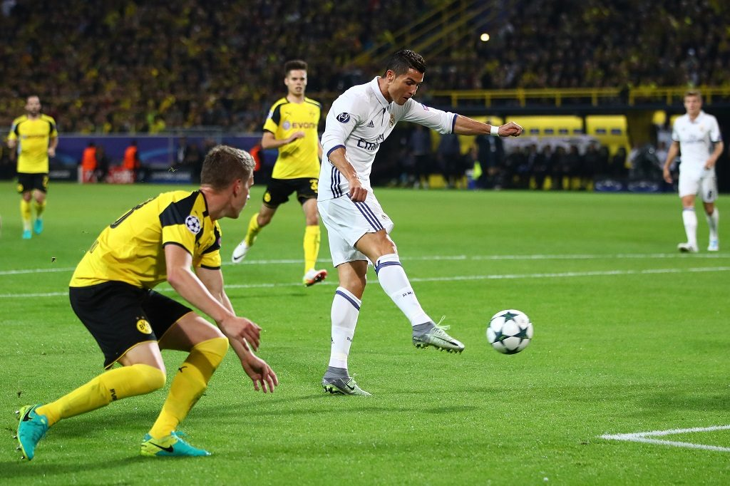 DORTMUND, GERMANY - SEPTEMBER 27:  Cristiano Ronaldo of Real Madrid scores their first goal during the UEFA Champions League Group F match between Borussia Dortmund and Real Madrid CF at Signal Iduna Park on September 27, 2016 in Dortmund, North Rhine-Westphalia.  (Photo by Alex Grimm/Bongarts/Getty Images)