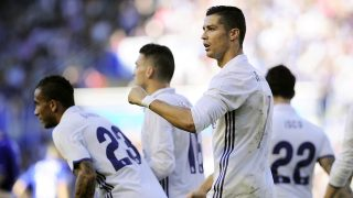 Real Madrid's Portuguese forward Cristiano Ronaldo (R) celebrates after scoring his team's second goal during the Spanish league football match between Deportivo Alaves and Real Madrid CF at the Mendizorroza stadium in Vitoria on October 29, 2016. / AFP PHOTO / ANDER GILLENEA