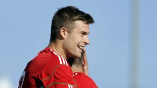Hungary's Marko Futacs (L) celebrates with a teammate after scoring a goal during the Under 21 international football match China vs Hungary, at the Perruc Stadium in Hyeres, southern France, on June 2, 2011. AFP PHOTO / ANNE-CHRISTINE POUJOULAT / AFP PHOTO / ANNE-CHRISTINE POUJOULAT