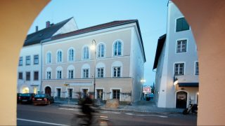 BRAUNAU AM INN, AUSTRIA - JANUARY 15:  (EDITORS NOTE: This image was created with a variable plane focus lens) A general view of the house where Adolf Hitler spent his early childhood on January 15, 2015 in Braunau am Inn, Austria. The Austrian government is reportedly considering forcing the current owner, an elderly woman whose name has not been published, to sell the house to the state after she has repeatedly refused to allow renovations. The government has rented the house, which dates back to the Renaissance and stands under cultural protection, in previous years and made it available for charitable causes in an effort to prevent its misuse by people seeking to glorify its Nazi link.  (Photo by Johannes Simon/Getty Images)