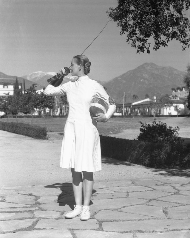 (Original Caption) Helene of Modern Troy is Greatest Swordswoman. Claremont, California: Helene Mayer, formerly of Germany, and now a resident of Los Angeles, and a student at Scripps College here, is in practice for her 1934 Battles at Arms. Miss Mayer is, perhaps, the greatest woman fencer of all time. She became champion of Germany in 1924 when she was only 13. And in 1927, she became Queen of all Europe. Then she won the 1928 Olympic title at Amsterdam and in 1933, she won the American championship. She is an international exchange student at Scripps College and is majoring in International Law and French.