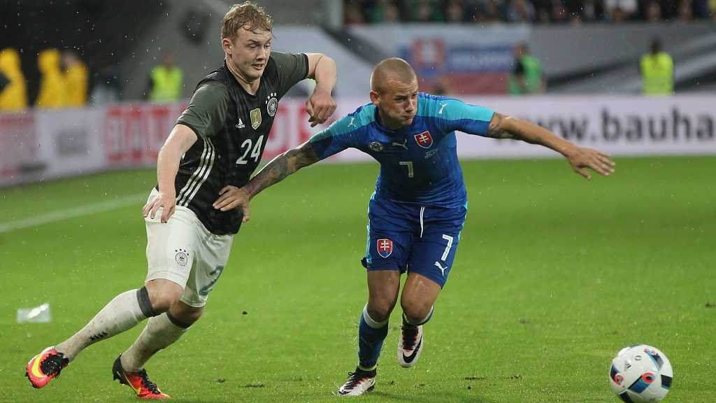 AUGSBURG, GERMANY - MAY 29:  Julian Brandt (L) of Germany fights for the ball with Vladimir Weiss of Slovakia during the international friendly football match between Germany and Slovakia at WWK-Arena on May 29, 2016 in Augsburg, Germany.  (Photo by Alexandra Beier/Bongarts/Getty Images)