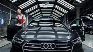 An employee performs a quality control check on the interior of an Audi S3 automobile inside the Audi AG production plant in Gyor, Hungary, on Monday, July 25, 2016. The European Commission is working with consumer groups and regulators in the European Union's 28 member states to pressure Volkswagen AG to give payouts to customers in the region caught in its emissions scandal, according to two people familiar with the issue. Photographer: Akos Stiller/Bloomberg via Getty Images