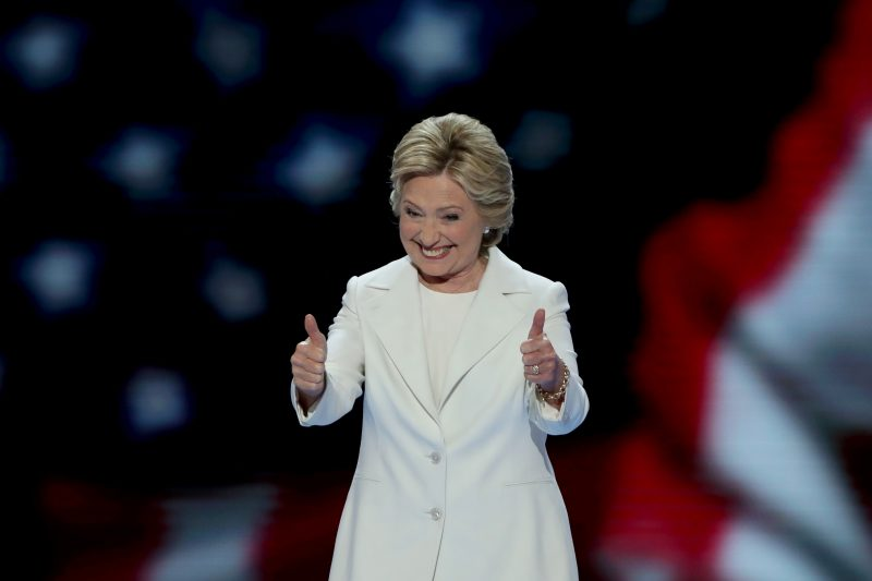 PHILADELPHIA, PA - JULY 28:  Democratic presidential nominee Hillary Clinton gives two thumbs up to the crowd as she arrives on stage during the fourth day of the Democratic National Convention at the Wells Fargo Center, July 28, 2016 in Philadelphia, Pennsylvania. Democratic presidential candidate Hillary Clinton received the number of votes needed to secure the party's nomination. An estimated 50,000 people are expected in Philadelphia, including hundreds of protesters and members of the media. The four-day Democratic National Convention kicked off July 25.  (Photo by Alex Wong/Getty Images)