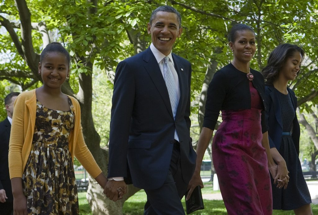 8 April 2012 - Washington, D.C. - President Barack Obama, First Lady Michelle Obama and daughters Sasha and Malia Obama walk across Lafayette Park to attend easter services at St. John's Episcopal Church. (Photo by Kristoffer Tripplaar/Pool/Corbis via Getty Images)