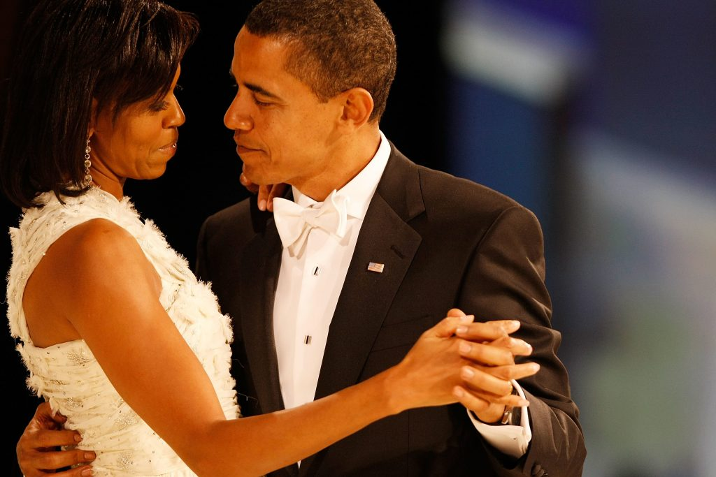 President Barack Obama dances with his wife and First Lady Michelle Obama during the Western Inaugural Ball on January 20, 2009 in Washington, DC. (Photo by Chip Somodevilla/Pool/Corbis via Getty Images)